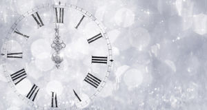 New Year's at midnight - Old clock and holiday lights Royalty Free Stock Image