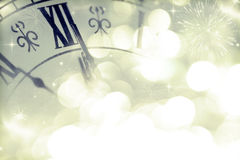 New Year's at midnight - Old clock and holiday lights Stock Photos