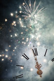New Year's at midnight - Old clock and holiday lights Royalty Free Stock Photography