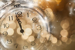 New Year's at midnight - Old clock and holiday lights Stock Image