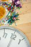 New Year's: Midnight Party Celebration Background. Background series good for New Year's Eve - with confetti, champagne, etc. and lots of copyspace on a wooden Royalty Free Stock Photo