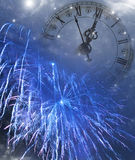 New Year's at midnight. Vintage clock on holiday background Royalty Free Stock Photography