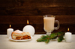 New Year`s mood, apple pie, cappuccino and spruce twigs on a wooden background Stock Photo
