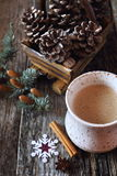 New Year's mood: milk coffee and pine cones Royalty Free Stock Photography