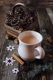 New Year's mood: milk coffee and pine cones Stock Images