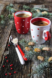 New Year's mood: two cups of coffee and pine branches. Christmas mood: two cups of coffee and pine branches on old wooden surface Royalty Free Stock Photography