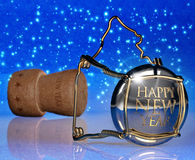 New Year's night. Champagne cork on a shimmering blue background Royalty Free Stock Photos