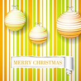 New Year's orange toys on a striped background Royalty Free Stock Photo