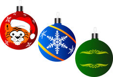 New Year's ornaments. Three images of New Year's toys for an ornament of  fur-tree Stock Photo