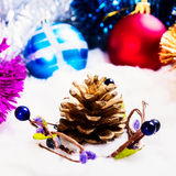 New Year's ornaments Pine cone.Christmas ,  cones, balls on snow. Royalty Free Stock Image