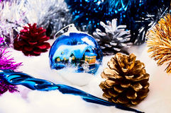 New Year's ornaments Pine cone.Christmas ,  cones, balls on snow. Royalty Free Stock Photography