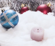 New Year's ornaments red blue candle. New Year's ornaments candle white Stock Photography