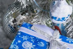 New Year`s photo. the New Year`s tree with imitation of snow is decorated with toys. Gifts lie under a fNew Year`s tree. Stock Photo
