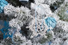 New Year`s photo. the New Year`s tree with imitation of snow is decorated with toys. Gifts lie under a fNew Year`s tree. Stock Photos