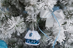 New Year`s photo. the New Year`s tree with imitation of snow is decorated with toys. Gifts lie under a fNew Year`s tree. Royalty Free Stock Photos