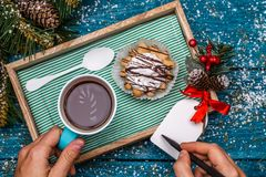 New Year`s photo of tea with picture of candycane and cakes Stock Photo