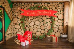 New Year`s photo zone, Christmas location. Celebration, studio with a wooden wall royalty free stock photography