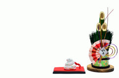 New Year's pine and the snake figurine. Royalty Free Stock Photos