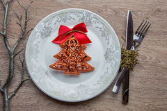 New Year's pine tree on plate as table decoration royalty free stock photos