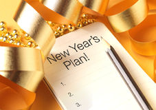 New year's plan. With gold color decorations. New Year's plan are resolutions or promises that people make for the New Year to make their upcoming year better royalty free stock images