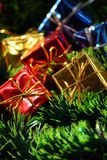 New Year's presents. Gold, red and dark blue presents Royalty Free Stock Photography