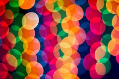 New Year`s rainbow bokeh. Holiday rainbow christmas lights bokeh background. royalty free stock photography