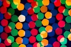New Year`s rainbow bokeh. Holiday rainbow christmas lights bokeh background. royalty free stock image