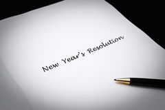 New Year's Resolution. Writing new year's resolutions on paper with black ballpoint pen Royalty Free Stock Photos