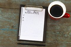 New Year`s Resolution written on a notepad and pen. New Year res. Olutions concept Royalty Free Stock Photos