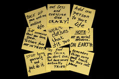 New Year's resolutions. Group of sticky yellow notes with a new year's resolutions on black backround Royalty Free Stock Photography