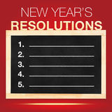 New year 's Resolutions : Goals List on Blackboard with red back Royalty Free Stock Photos