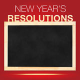New year 's Resolutions : Goals List on Blackboard with red back Royalty Free Stock Image