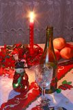 New Year's setting with wine, glass, tangerines Stock Images