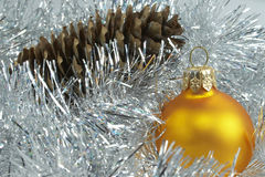 New Year's sphere and pine cone Stock Photography