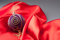 New Year's sphere  on a red fabric Royalty Free Stock Photography