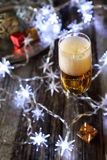 New Year's spirit: glass of champagne and Christmas decoration Royalty Free Stock Photo