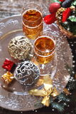 New Year's spirit: two glasses of champagne and Christmas decora Royalty Free Stock Images