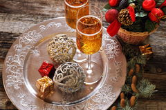 New Year's spirit: two glasses of champagne and Christmas decora Stock Photos