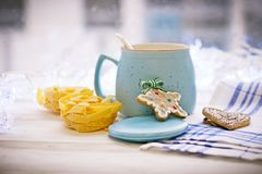 New Year`s still life with asugar bowl, spoon, cookies, pasta royalty free stock photo