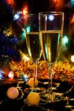 New Year's still-life with champagne. And a lighting garland Royalty Free Stock Images