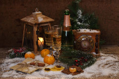 New Year's still-life with champagne, tangerines and chocolate Royalty Free Stock Images