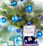 New Year's still life consisting of branches of a fir-tree of blue spheres and boxes with gifts Royalty Free Stock Photo