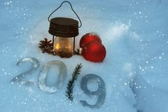 New Year`s still-life with a flashlight in the forest in the snow white snow, soon 2019.  Royalty Free Stock Photo