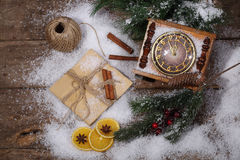 New Year's still-life with hours, snow and fur-tree branches Royalty Free Stock Images