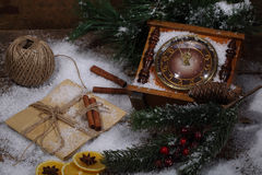 New Year's still-life with hours, snow and fur-tree branches Stock Photos