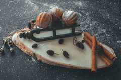 New Year`s still life with nuts, on a sleigh with cinnamon stock photography