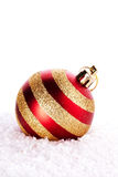 New Years striped ball on snow. Royalty Free Stock Images