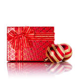 New Year's striped red balls and gift. Stock Photos