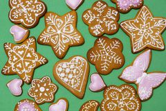 Homemade ginger cookies on a green background. New Year`s sweets cooked at home. View from above Stock Images