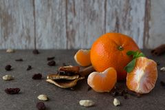 New Year`s tangerines on a wooden background stock photo